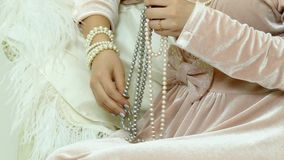 Pearls in hands stock footage
