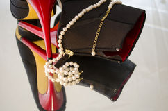 Pearls and high heels. A pearl necklace draped around a pair of high heel shoes Stock Photos