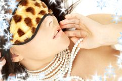 Pearls and leopard mask Stock Photo