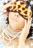 Pearls and leopard mask Stock Image