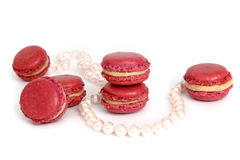 Pearls and Macarons. Pearls and french macarons on white background Royalty Free Stock Photography