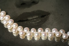 Pearls on mirror. Pearls on painted mirror Royalty Free Stock Photos