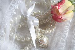 Pearls n Lace. Lace elegance adorned with pearls and fresh rose royalty free stock photography