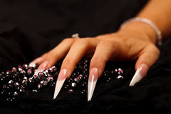 Pearls and nails Royalty Free Stock Image
