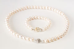 Pearls necklace. Bracelet on white background Stock Photos