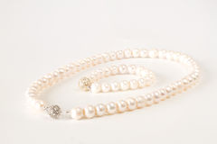 Pearls necklace. Bracelet on white background Stock Photography