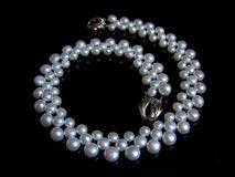 Pearls necklace. On black background stock images