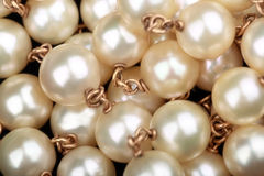 Pearls. Necklace closeup with golden chains Stock Photo