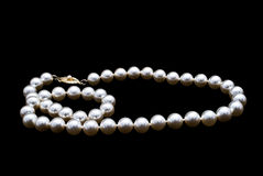 Pearls necklace on black background Royalty Free Stock Images