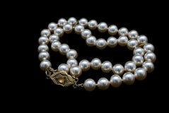 Pearls necklace on black background Royalty Free Stock Photos