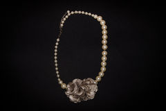 Pearls necklace with flower Royalty Free Stock Photos