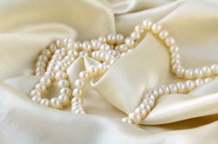 Pearls a necklace on a silk Stock Photos