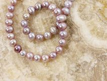 Pearls necklace on a stone Stock Image