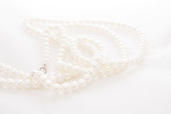 Pearls necklace. On a white background Royalty Free Stock Photos