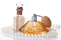 Pearls with old perfumes Royalty Free Stock Photos