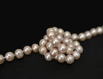 Pearls over black Stock Images