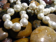 Pearls over river rocks Stock Image