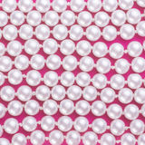 Pearls on pink background. Pearls white  on pink background Stock Photos