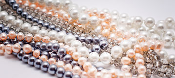 Pearls, plastic and glass jewelry. Strings of jewelry: pearls, plastic and glass stock image