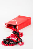 Pearls and red bag Royalty Free Stock Photography