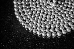 Pearls. Reflection pearls on the floor like pieces of pearls Royalty Free Stock Photo