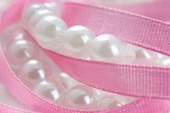 Pearls and  ribbon Royalty Free Stock Photos
