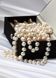 Pearls and rings in black jewelry box Royalty Free Stock Image