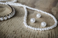 Pearls on Rustic Wood Stock Image