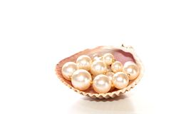 Pearls in a seashell. With white space Royalty Free Stock Photography
