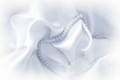 Pearls on silk fabric Royalty Free Stock Photo