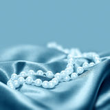 Pearls on a silk fabric background Royalty Free Stock Photography