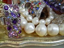 Pearls silver and gems jewelry Stock Images