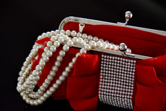 Pearls Over Red Royalty Free Stock Photos