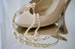 Pearls tiara and shoes Stock Photos