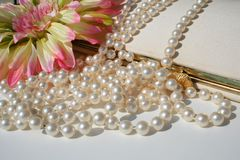 Pearls and vintage purse Stock Photo