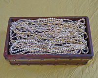Pearls in vintage wooden crib Royalty Free Stock Images
