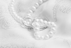 Pearls and wedding bangs. Black-and-white. Wedding background: pearls and wedding bangs on a fabric. Black-and-white royalty free stock images