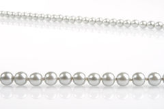 Pearls on white. Pearl necklace on white background Royalty Free Stock Images