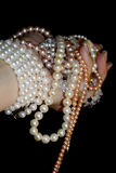 Pearls in women hand. Bunch of pearls in women hand Royalty Free Stock Images