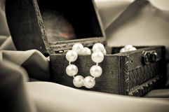 Pearls in the wooden chest Royalty Free Stock Photo