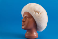 Pearly beret from natural mink on mannequin. Stock Photos