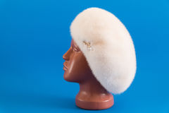 Pearly beret from natural mink on mannequin. Stock Photo