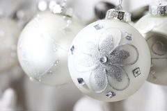 Pearly christmas balls with designs of bright brilliant flowers. Pearly christmas balls with designs of bright brilliant silver flowers stock photography