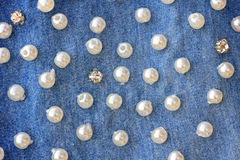 Pearly denim background. With glossy pearls Stock Image