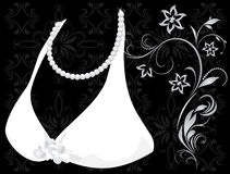 Pearly necklace and dress. Fragment Royalty Free Stock Photo