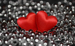 Red hearts on pearly silver background Royalty Free Stock Photo