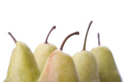 Pears. A few yellow pears on a white background, close-up Stock Photo