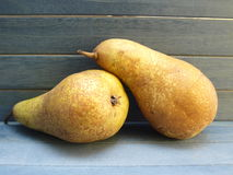 Pears. Two pears on a blue wooden background Royalty Free Stock Photography