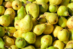 Pears. Pile of ripe pears on a marketplace. Bright  colors and rich contrast Royalty Free Stock Image