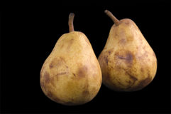 Pears. Two pears over black background Stock Photography